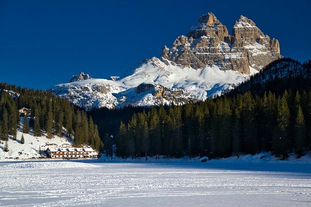 The frozen Lake Misurina and the Lavaredo peaks in winter