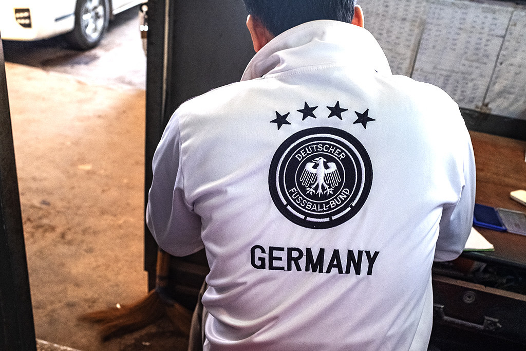 GERMANY jacket worn by man at North Station--Vientiane