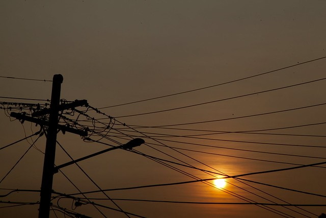 Sunrise and telegraph wires