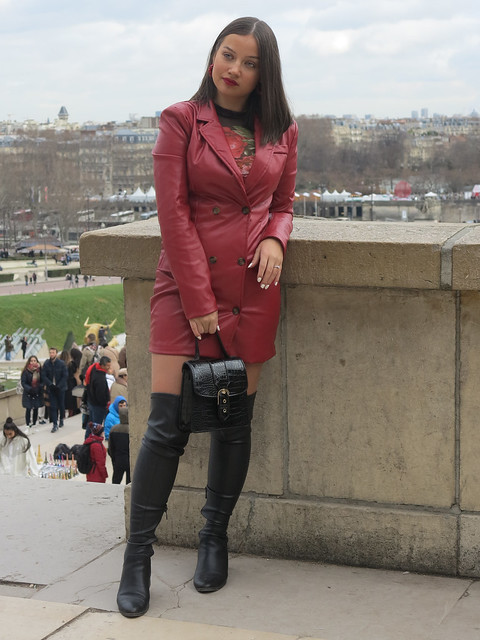 Charming Russian girl in leather jacket and otk boots