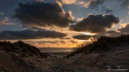 Dunes, beach, sea and clouds