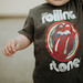 A kid wearing a rolling stone tshirt smiling