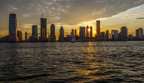 dusk night sunset sun water landscape urban buildings newyork newjersey hudsonriver usa america boat reflection