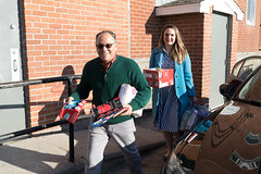 State Rep. Stephanie Cummings and Edwin Rodriguez, development director for St. Vincent DePaul Mission of Waterbury, carry donations from  the annual Holiday Giving Tree to the St. Vincent shelter.