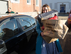 State Rep. Stephanie Cummings  carries donations from the annual Holiday Giving Tree to the St. Vincent DePaul Mission of Waterbury.
