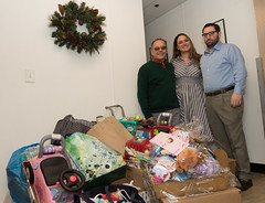 State Rep. Stephanie Cummings joined Edwin Rodriguez, development director (left) and Anthony Guerrera, case manager for St. Vincent DePaul Mission of Waterbury, with the large pile of donations from the annual Holiday Giving Tree brought to the St. Vincent shelter.