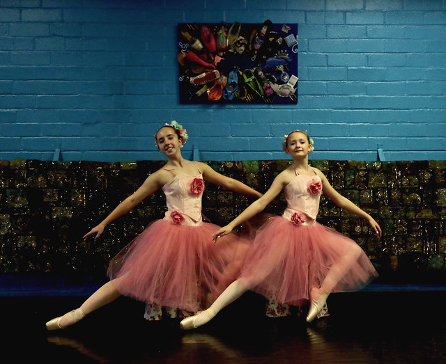 Two Young Ballet Dancers Pose For The Camera