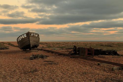 dungeness kent shingle beach pebble sun set sunset fishing boat wreck wood wooded