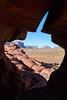 Peeking Through Rocks - Vertical