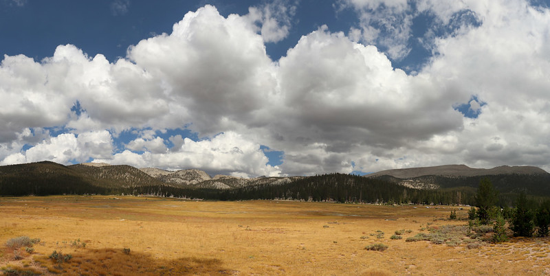 Panorama of Big Whitney Meadow with cumulus clouds, with Cirque Peak on the right