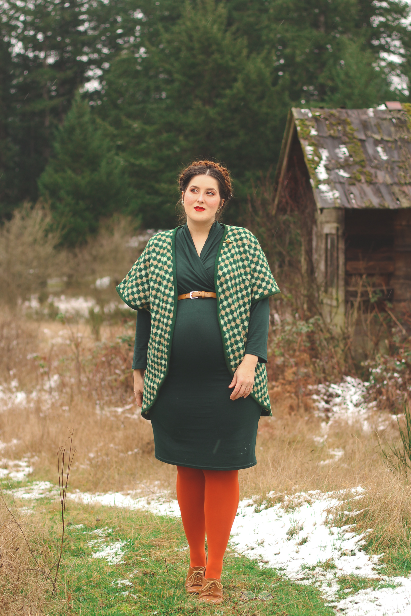 woman wearing green plaid in a snowy field