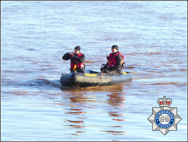 Policemen in a Dinghy ..