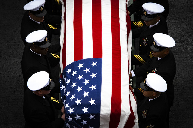 Chief petty officers carry a casket aboard USS Theodore Roosevelt (CVN 71) during a burial at sea, Jan. 20, 2020.