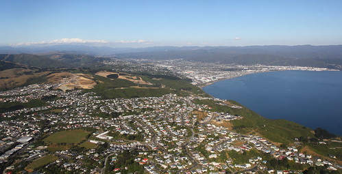 <p>An aerial shot looking across the head of Wellington Harbour, and Newlands and Paparangi (foreground), to the Hutt Valley and Lower Hutt, with Upper Hutt just visible in the far distance.  The Tararua Range (far left and centre) and Remutaka Range (right) form the skyline mountains.</p>