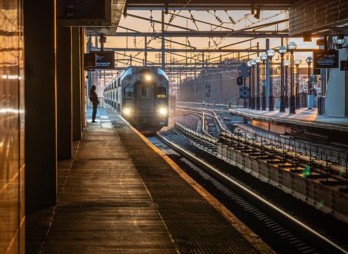 streetphotography candidphotography train7019 njtransit secaucusjunction secaucus nj train station platform woman passenger commuter sunset johnstjohn johnstjohnphotography