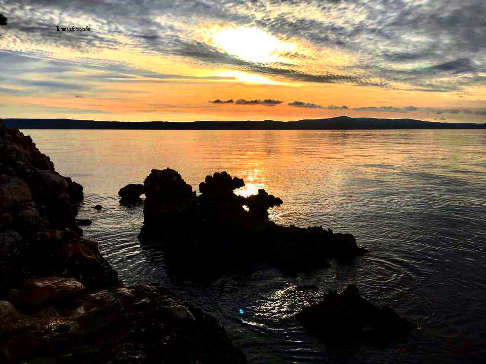 In the winter if there are no tourists, at sunset the dragons come out of the sea, but only if the water is like a mirror, photo taken in Drašnice, Croatia