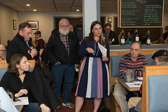 State Rep. Stephanie Cummings talks with constituents during Pizza and Politics gathering at Domenic's and Vinnie's Pizza.
