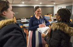 State Rep. Stephanie Cummings talks with Melissa Clarke and Laura Callachan after hosting Pizza and Politics gathering at Domenic's and Vinnie's Pizza.