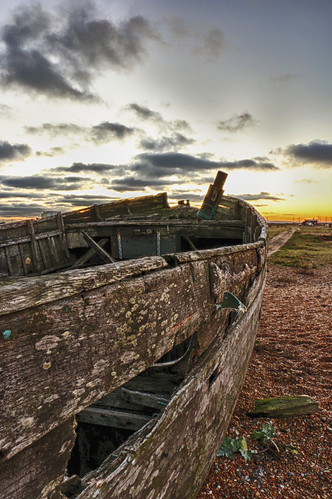hdr dungeness kent shingle pebble beach sun set sunset wooden fishing boat wreck