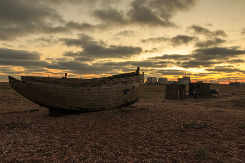 dungeness kent sun set sunset shingle pebble beach wooden fishing boat wreck wood