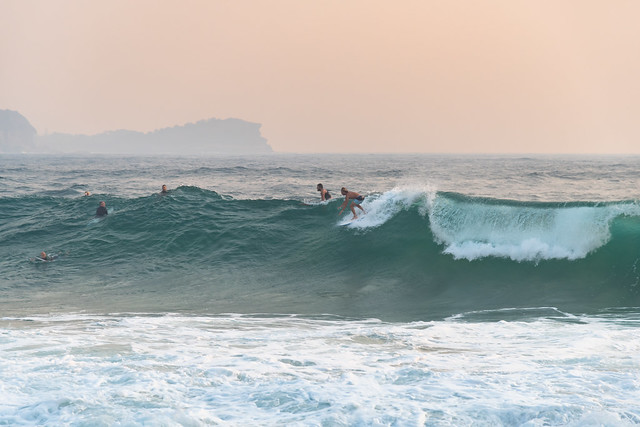Early Morning Surfers and Hazy Seascape
