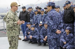 t. j.g. Shane Shuman gives a tour of USS Emory S. Land (AS 39) to members of the Japan Maritime Self-Defense Force in Kure. (U.S. Navy/MC2 Jordyn Diomede)