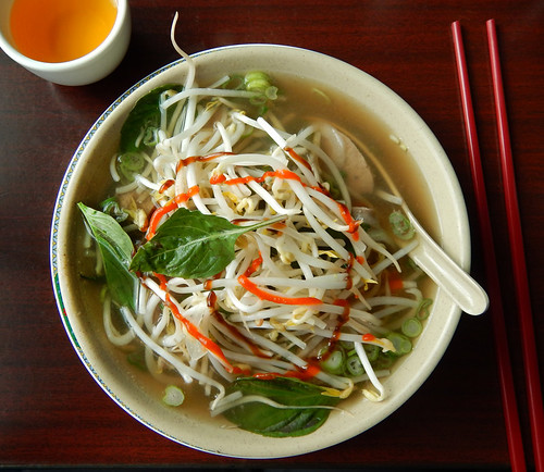 Pho (beef noodle soup from Vietnam) with Thai basil, bean sprouts and hot sauce added