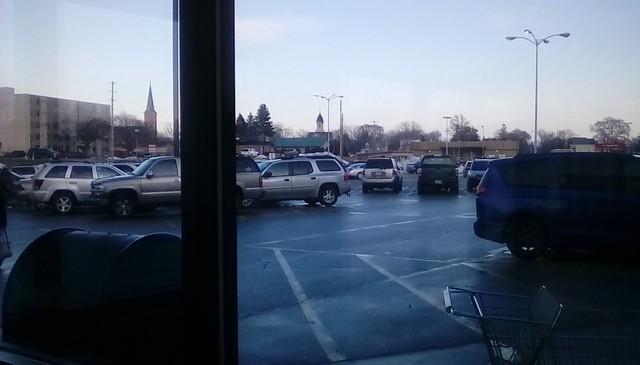 Supermarket parking lot through the window! - HWW Menominee Michigan