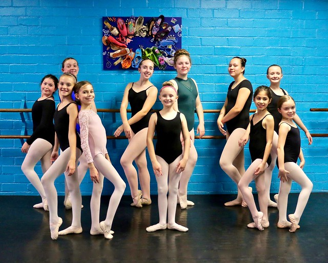 Young Ballet Dancers Posing For The Camera