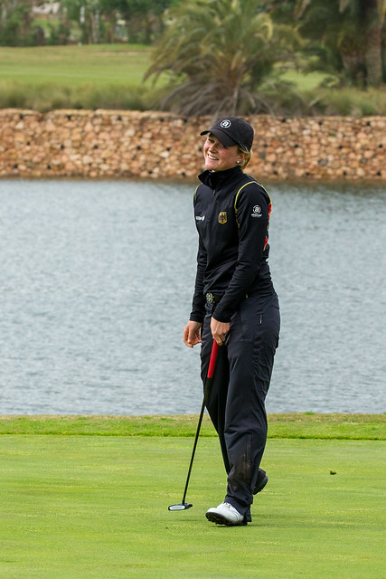 Sophie Hausmann of Germany smiles having holed a long birdie putt on the 17th hole during the third round