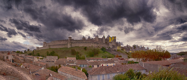 """Moody panorama, that night there was torrential rain and widespread flooding. The UNESCO site, Carcassonne, """"Cité de Carcassonne"""", Aude, Occitanie, France."""