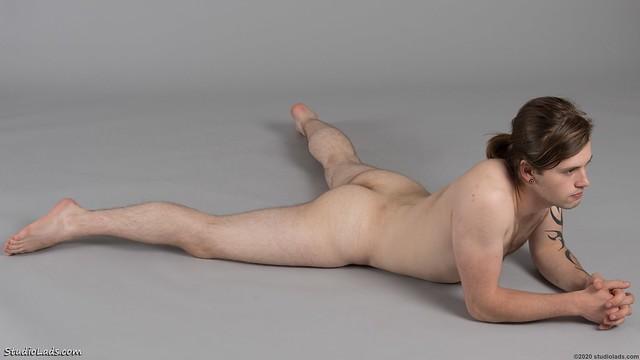 Naked guy on floor