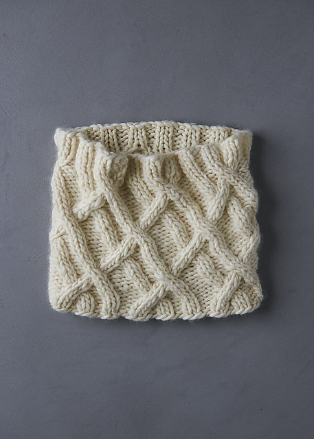Here is another free cozy cowl - Purl SoHo's Wandering Cable Cowl using a super bulky yarn!