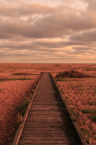 dungeness kent shingle pebble beach boardwalk board walk sun set sunset wood