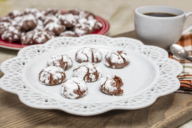 Chocolate Almond Crinkle Cookies on a White Plate