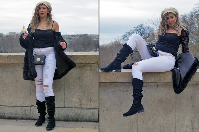 Sexy girl posing with boots, cap and white jeans