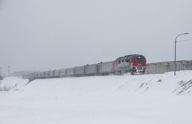 TEP70BS-258 diesel locomotive with suburban passenger train