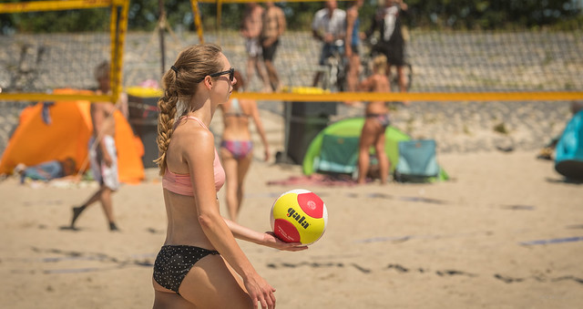 Playing beach volleyball.