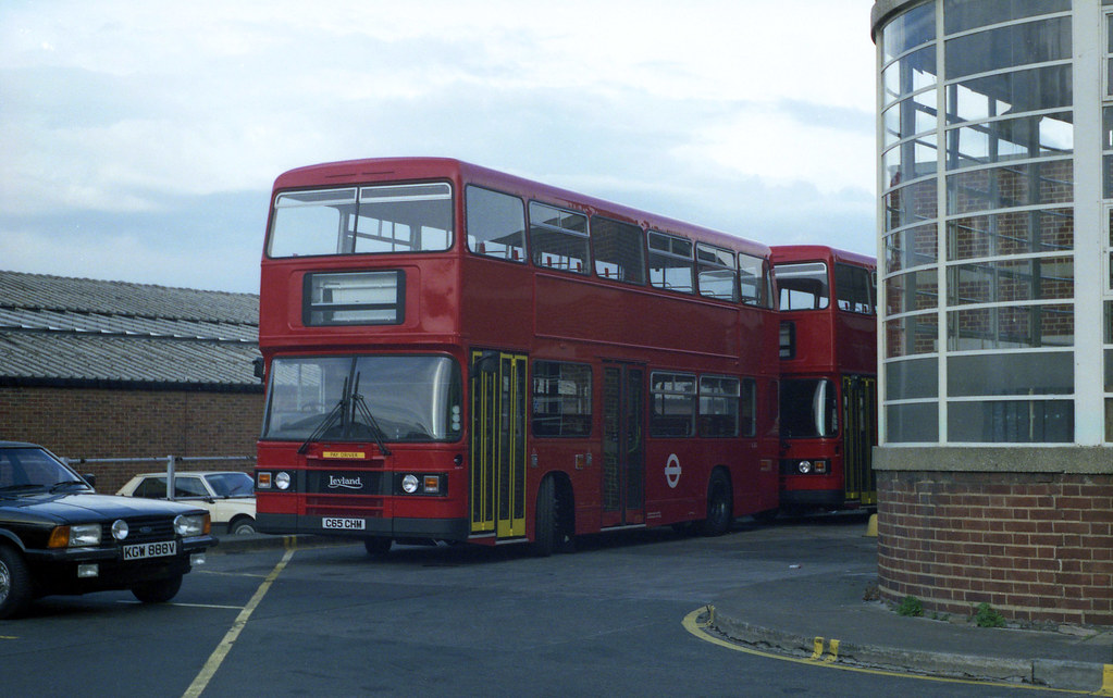 Brand new Olympian bus L65 is seen parked with another behind at Bexleyheath Garage on  23-4-86. They were moved from Plumstead earlier for staff training prior to entering service. Copyright Ian Cuthbertson