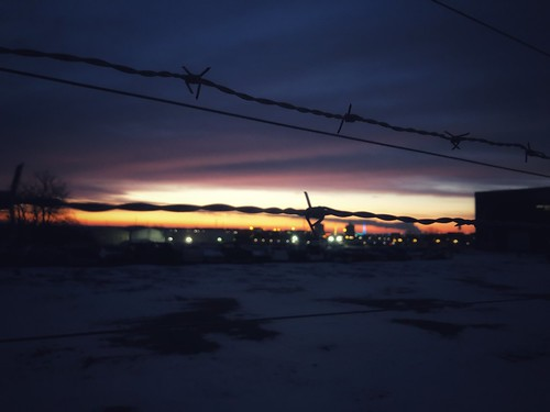 iphonology iphoneology iphoneographer iphoneography midwest cityscape sunset sunrise barbedwire fence northomaha nebraska omaha