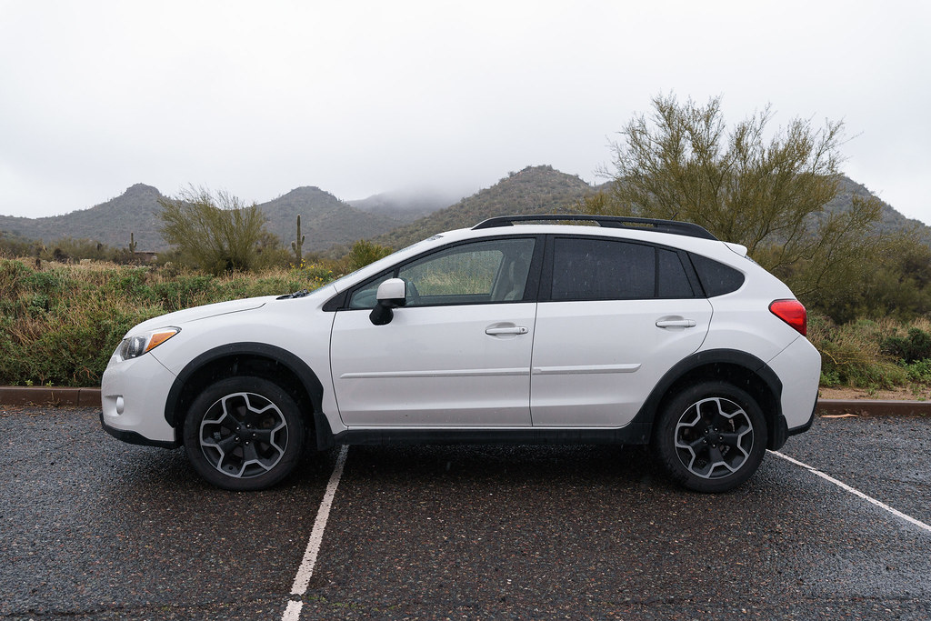 My 2013 Subaru XV Crosstrek Limited sits in a downpour in the desert, taken at Cave Creek Regional Park in Cave Cree, Arizona in December 2019
