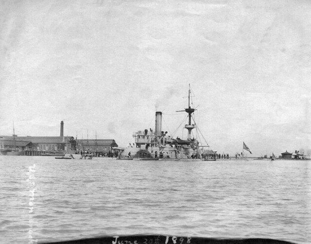 USS Monadnock (BM-3) and Camanche aft of her in the Mare Island channel on 20 June 1898. To the far left, just visible, are the earthquake damaged east ends of building 85 and 91. The earthquake hit on 30 March 1898.