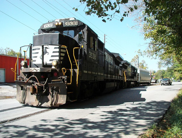 Norfolk Southern Railroad GE B23-8 locomotives # 3538 & # 3522 are seen while leading a southbound train consisting of one covered hopper car on a branch line as it heads back to the yard in Asheville, North Carolina 9-28-2010