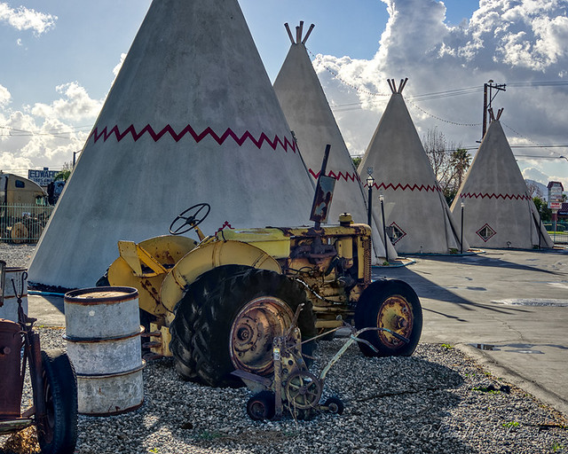 Tractor & Row of Teepees at Wigwam Motel on Route 66 in Rialto, California in HDR