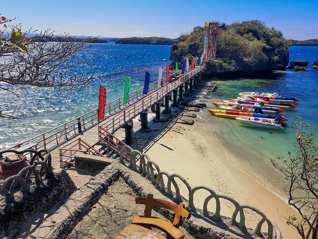 A footbridge going into a small rock island.