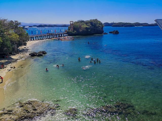 Paradise like swimming on tropical beach.