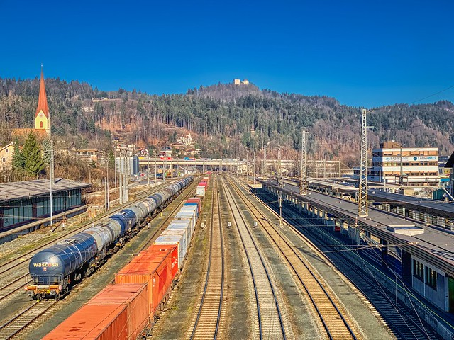 Kufstein train station with freight trains and Thierberg mountain in Tyrol, Austria