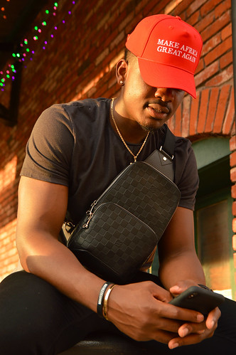 downtown bricktown 2019 july portrait yak youngafricankings makeafricagreatagain hat red brick cellphone sunset junior african basketball player