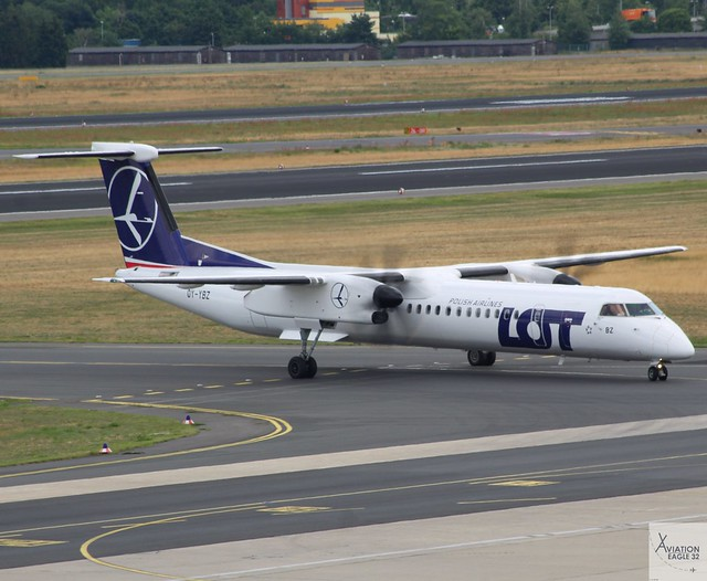 LOT Polish Airlines DHC-8-Q402 OY-YBZ taxiing at TXL/EDDT