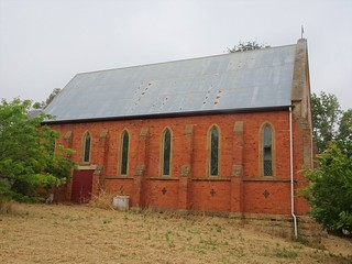 Merino. Side view of the red brick Anglican Church. The ends are local sandstone. The foundation stone was laid in 1865 and has been replaced with a new one in 1990. The church opened in 1867.